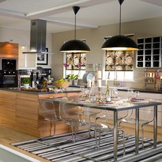 Love the low pendants over the kitchen table area.