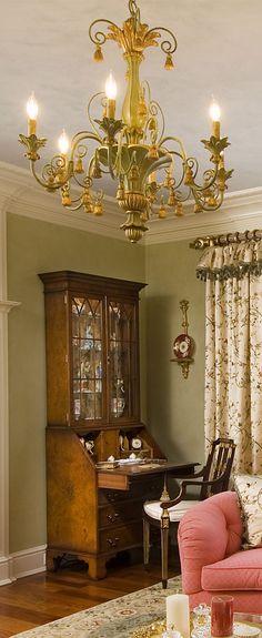 Italian carved wood chandelier with tassels motif in the living roo; living room lighting ideas; wood chandeliers