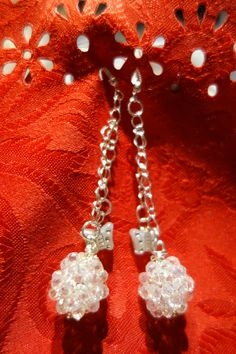 orecchini fai da te (hand made) con swarosky  bianchi e farfallina.