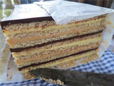 """I saw this dessert on Anthony Bourdain """"Parts Unknown""""  (Quebec) and I want to make it!! It's Gateau Marjolaine  and it consists of layers of almond, hazelnut meringue and chocolate buttercream."""