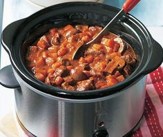 slow cooker filled with beef, mushroom, tomato and swede stew