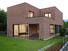 It's intriguing to see a modern house done completely in brick.