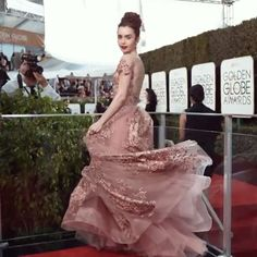 WEBSTA @ lilyjcollins - Perfecting the swoosh #GoldenGlobes...