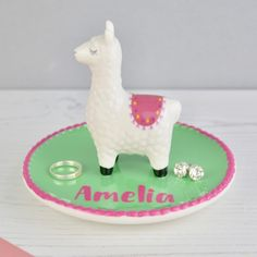 We were in love when we saw the eyes. this cute llama makes a great jewellery and trinket dish. A ceramic dish is green with a pink scalloped edge. Looking to give an extra special gift? Alpacas, Llamas Animal, Flamingo, Biscuit, Teen Christmas Gifts, Llama Gifts, Cute Llama, Llama Alpaca, Idee Diy