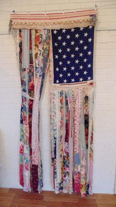 One of a kind door curtain. Up-cycled from various sources ... antique fabrics, ticking, lace, Ralph Lauren sheets, and floral prints in a variety of textures and designs. The edges have been left raggedy for effect. There is a layer of wide lace strips on backside Fabric strips hang loose to easily pass through the curtain. This can also be hung on the porch, behind a bed, in a window, or on a wall. The aprox size is 34 X 80  Rod pocket at top for hanging. If you need to hang this with…