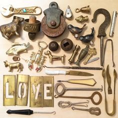 Random metal objects,collection, vintage, antique, love, words.