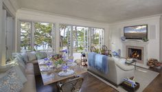 Pebble Beach Great Room - wall of french doors and corner window banquette bring in the spectacular views of ocean and cypress.
