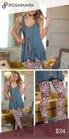 """NEW! Scoop Neck Ruffle Tank This Scoop Neck Ruffle Tank pairs beautifully with the Multi-Color Mixed Print Leggings. Dusty Blue/Dark Green color. 95% rayon, 5% spandex. Bust measures (lying flat armpit to armpit): S - 17"""", M - 18"""", L - 19"""". Length measures as follows: S - 27"""", M - 28"""", L - 29"""". Infinity Raine Tops Tank Tops"""