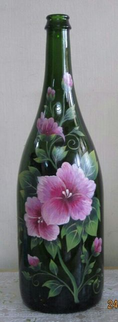 Painting on a wine bottle. I love this