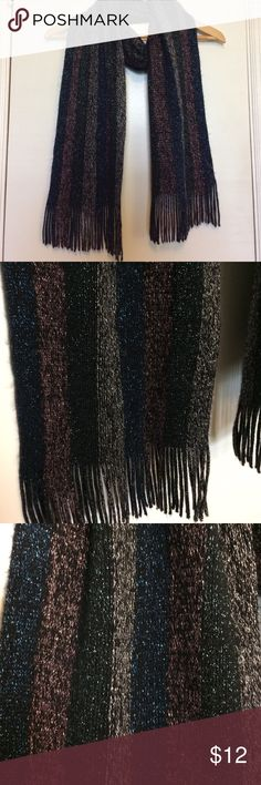 Urban Outfitters Sparkly Striped Scarf In very good, gently used condition. I always received many compliments when wearing this scarf! Shades of black, blue, green, pink and silver sparkly stripes. Measures 78 inches long and 8 inches wide. Urban Outfitters Accessories Scarves & Wraps