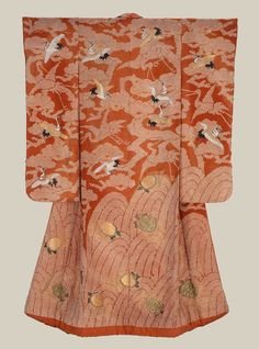 """Silk 'uchikake' (wedding over-kimono).  First half 19th century, Japan. """"Silk damask (rinzu), tie resist-dyed (kaneko shibori) and embroidered with silk and couched with gold-wrapped threads. Reddish-orange silk damask with design of tie-dyed waves at bottom embroidered with tortoises (minogame) and tie-dyed pine trees above embroidered with flying cranes (tsuru);"""".  MFA. (William Sturgis Bigelow Collection)"""