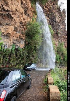 "Waterfall, old coastal road, also called the ""car washing road"" , Madeira, Portugal"