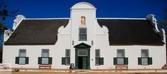 Traditional Cape Dutch architecture invites visitors to lie back and sip slowly on a glass of smooth merlot as the sun sets behind Table Mountain. Cape Dutch, Dutch House, Table Mountain, South Africa, Tourism, Castle, Sun Sets, Traditional, Mansions