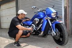 Salman Khan with his bike in his garage