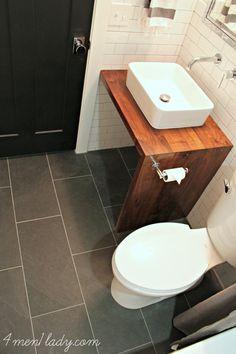 Black door, wood vanity, vessel sink, subway tile. 4men1lady.com