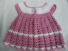 ***Cute Pink Crochet Baby Dress for a 0-3 Months old Baby Girl*** It is soft and warm. It buttons in the back and the collar is wide. Note the sleeve is short. 81% Acrylic 19% Nylon Skirt measures 7 Long :)