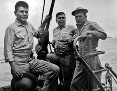 U.S. Marine Code-Talkers PFC Hosteen Kelwood (Navajo), Pvt. Floyd Saupitty (Comanche), and PFC Alex Williams (Navajo) five months after participating in the battle of Peleliu - 1945
