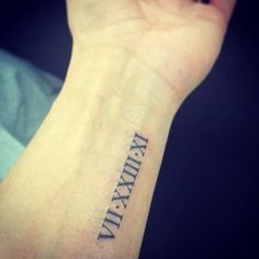 Wedding date Roman numeral arm tattoo