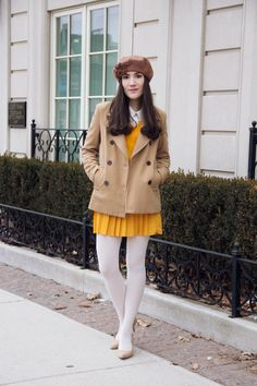 Awesome mustard against plaques white tights. Traffic-stopping chic! Love it!