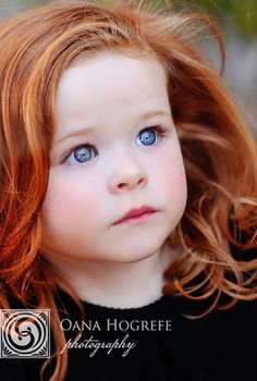 I hope our red headed babies are this beautiful. Look at those baby blues. I think Molly Kate will look like this when she gets older!