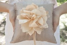 Our raw silk ring bearer pillow with a handmade blush silk flower  ------New bridal accessory collection is out on our Etsy now!  www.etsy.com/shop/handandheritage