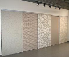 Multi-pattern yet neutral sliding closet doors. Nice! Via Modello Designs.
