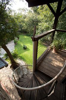Spiral stairs to back yard from bedroom