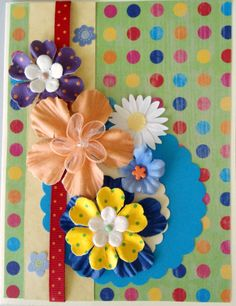"""This card could easily be called """"overload"""" - I picked my background piece (containing most of the colors in the flowers I planned to add; put a neutral strip down the side and added a ribbon; the rest is just pile 'em on until you like how it looks..."""