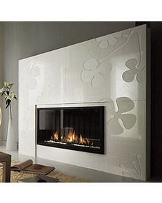 Design Fireplace from Chazelles - this is really cool - i love the flower relief