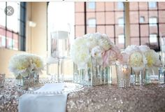 Tables with sequin tablecloth & short centerpiece