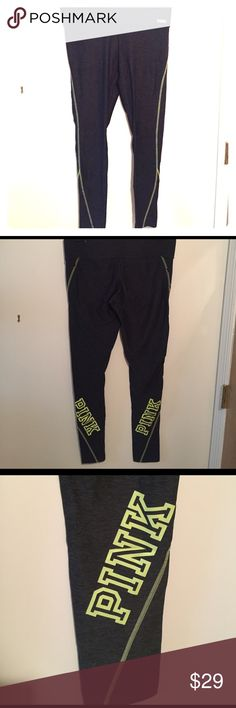 """Victoria's Secret Pink workout leggings Workout leggings from Pink. Charcoal gray with neon yellow seams and Pink logo. Pass the squat test. Good for tall girls, I'm 5'8"""" and they didn't stop at my ankle like most leggings. PINK Victoria's Secret Pants Leggings"""