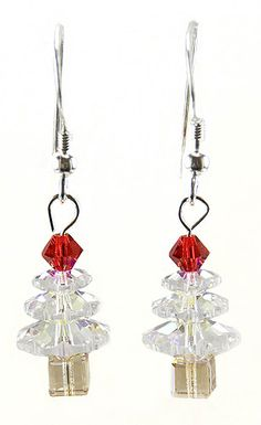 23202  Swarovski Crystal AB Christmas Tree Earrings Kit  Create a sparkling pair of Christmas tree earrings made entirely of Swarovski crystal beads.  Kit includes everything you need to make one pair of earrings.  There are three sizes of crystals that make up the center, a bicone top, cube trunks and sterling silver head pins and ear wires.  All the facets on these trees will really light up your ears!