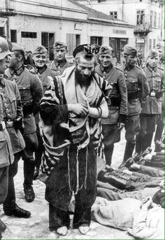 A rabbi (?) Sneered at by German soldiers, at a death camp. God have mercy...