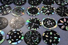 Designs on a CD. Black acrylic paint - then scratch design.