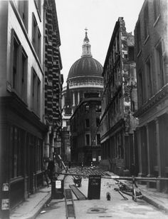 November 1940: A cordoned off area of Cheapside where bomb damage made the buildings unsafe. The dome of St Paul's is in the distance. Picture: Fox Photos/Getty Images