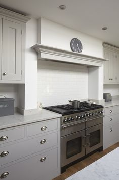 Traditional painted kitchen in Hinchley Wood, Surrey featuring a larder, Teltos Carrara worktop, Rangemaster cooker and canopy. Kitchen Mantle, Kitchen Chimney, Kitchen Decor, Kitchen Cabinets, Kitchen Ideas, Shaker Cabinets, Kitchen Living, New Kitchen, Living Rooms