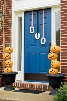 Halloween Decorations for the front door with light up pumpkin stacked on a rod and BOO door letters