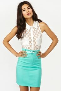 Mint denim skirt with a white dotted crop top.