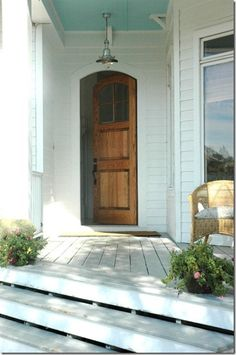 love the door, and the wood with the white exterior