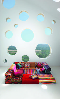 I am absolutly in love with the style of this lounge seating as well as the hippie-patchwork patterns of the fabric.   mah-jong roche bobois