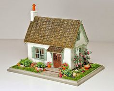 """Good Sam Academy of Miniatures 2014: 1/144"""" Scale Victorian Cottage. Taught by Nell Corkin  This is a fun project, whether you have tried 1:144 scale before or not. According to Nell, working in 1:144th scale is similar to making accessory items in 1:12 scale, something most of us have done. Some experience with accurate cutting and measuring in any scale is the only requirement for this class.  http://goodsamshowcase.miniature.net/GSAM_Academy/2014/goodsamacademy_2014.htm#Class%20#2"""