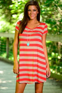 This striped beauty is a must have! The relaxed, t-shirt style is right on trend and the coral and tan color combo is perfection! This dress is the easiest way to be an in-the-know fashionista!