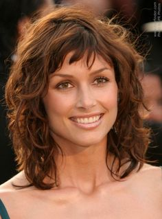 Medium Curly Layered Hairstyles With Bangs