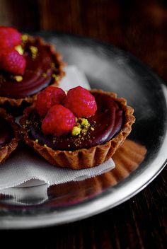 dark chocolate raspberry pistachio tartlets...