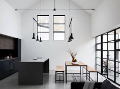 Kitchen with lofty ceiling and monochrome palette