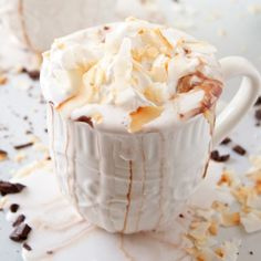 Coconut Hot Chocolate with Coconut Whipped Cream all topped with toasted coconut shavings
