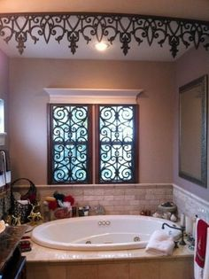 My father actually designed these faux iron treatments. The window pieces are installed on hinges with shutter frames. The crowned faux iron drop on the ceiling frames the tub area in beautifully. Ikea Hacks, Small Bathroom Window, Wrought Iron Decor, Window Grill, Tuscan House, Tuscan Decorating, Iron Doors, Window Coverings, Window Treatments