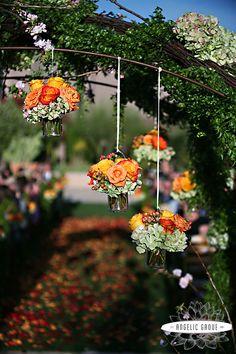 Gorgeous floral design on this rose wedding trellis