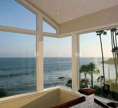 This would be my dream bedroom, with doors that open to reveal a clear view of the ocean right at the foot of your bed!