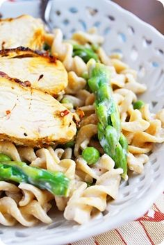 Chicken Pasta - chicken - rotini - asparagus - frozen green peas - butter - garlic clove - chicken or vegetable broth - cornstarch - heavy cream - lemon - crushed red pepper flakes